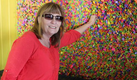 Jan placing wish in the Wishing Wall