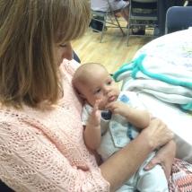 Jan holding baby, Ian Mata