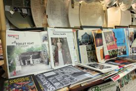A few of the many magazine articles about the Barney Smith Toilet Seat Art Museum