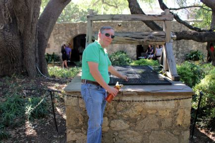 Phil making a wish at the Wishing Well at the Alamo