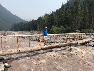 Phil on log bridge over White River