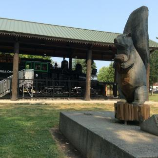 Squirrel statue aand locomotive by library