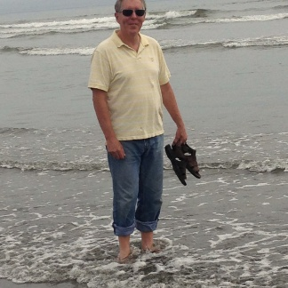 Phil enjoying the cool ocean