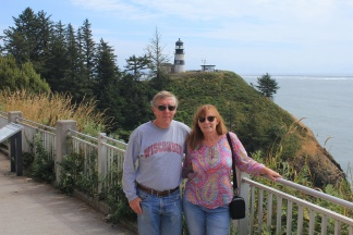 Phil and Jan with Cape Disappointment Lighthouse in background