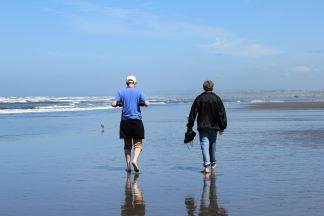 Jason and Phil walking down beach