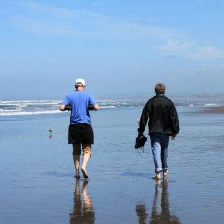 Jason and Phil walking down beach