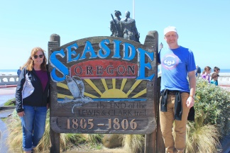 Jana and Jason by Seaside sign