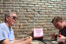 Phil and Jason enjoying Voodoo Doughnuts