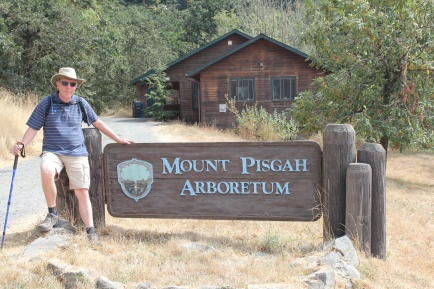Phil at Mount Pisgah Arboretum sign