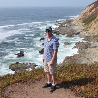 Phil overlooking Pacific cliffs