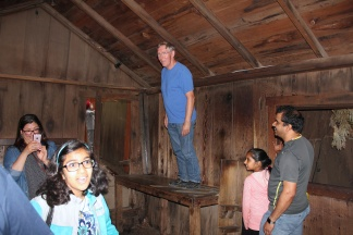 Phil standing straight up in shed