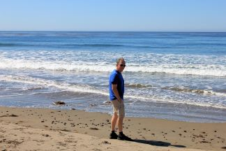 Phil taking walk on beach