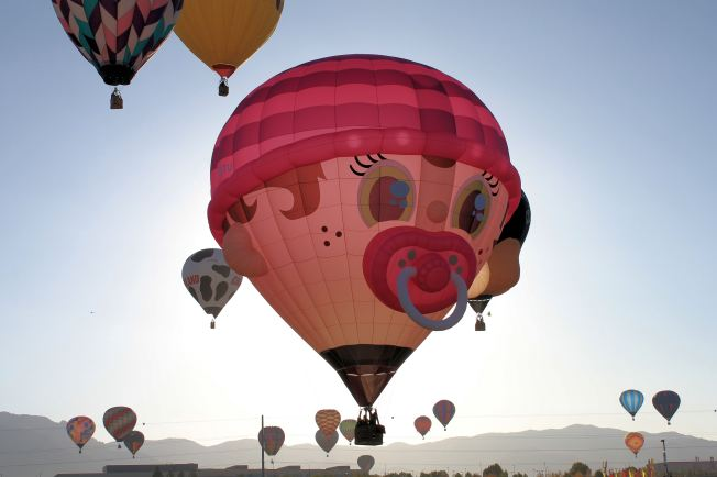 Baby balloon and others fly aloft