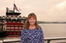 Jan on Riverwalk overlooking Mississippi River