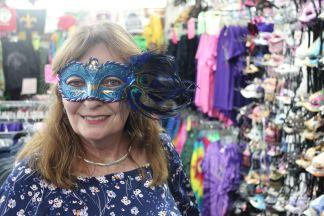 Jan shopping for a Mardi Gras mask
