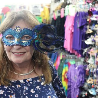 Jan shopping for a Mardi Gras mask