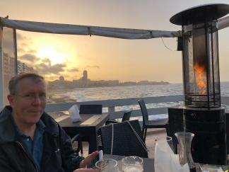 Phil at dinner overlooking Mediterranean