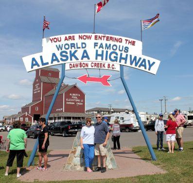 Jan and Phil at Alaska Highway sign