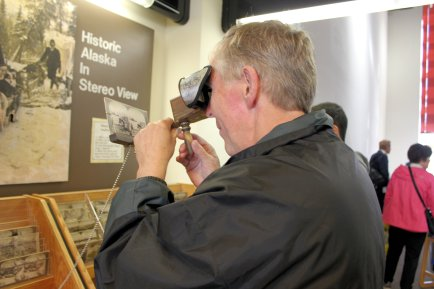 Phil using stereoscope to look at old pictures