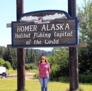 Jan at Homer sign