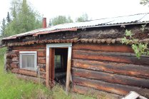 Tin roof added by mining company on top of original sod roof