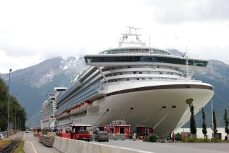two cruise ships moored at dock