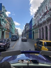 Driving through a restored section of Havana