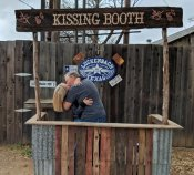 Phil and Jan in the Kissing Booth