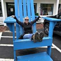 Jan in Adirondack chair at gift shop