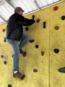 Phil on climbing wall