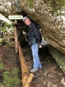 Phil climbing through Arch Rock