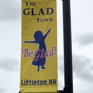 The Glad Town street banner
