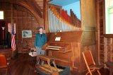 Jason with organ in church on Little Cranberry Island