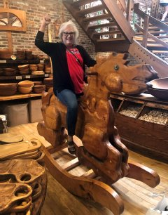 Sheila horseback in the In the Woods store