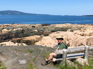 Phil sitting on bench overlooking Frenchman Bay