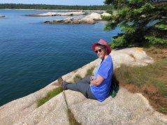 Jan having a snack on shoreline rock