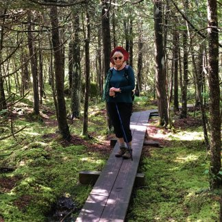 Jan on boardwalk through cedar swamp
