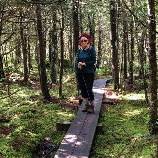Jan on boardwalk through cedar swamp