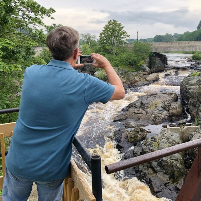 Phil taking picture of falls
