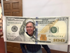 Phil as face of $100 bill