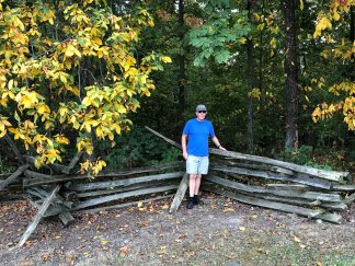 Phil with typical fencing built without nails or post holes