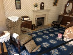 Eliza Johnson's bedroom with reclining chair where she spent most of her time due to TB