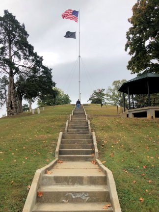 Phil climbing stairs to Johnson burial plot