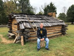 Phil at replica of the Crockett family cabin