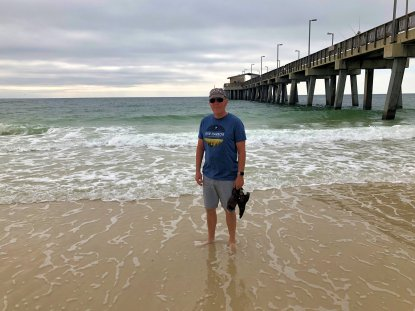 Phil wading beside the pier