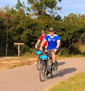 Jason and Jarrod riding bikes at Gulf State Park