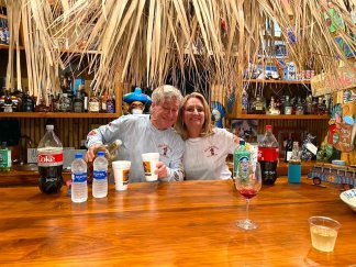 Hill and Donelle Dishman in their tiki bar