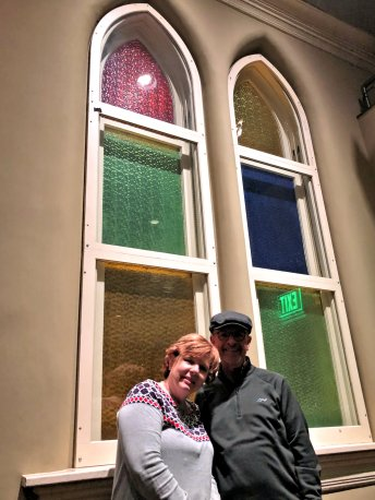 Brenda & Philip by Ryman's stained glass windows