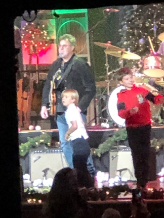 Vince Gill and kids on stage