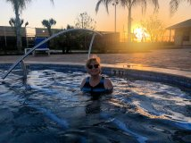 Jan in hot tub at sunset